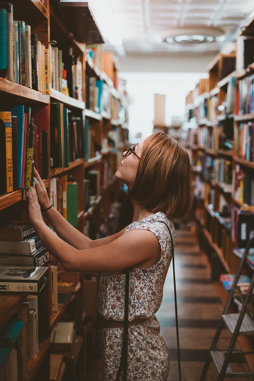 Woman looking at a shelf of books