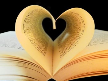 Book with pages turned in so they form a heart