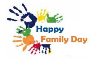 Coloured hand prints around Happy Family Day