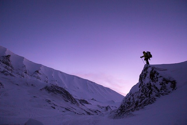person standing on snowy mountain