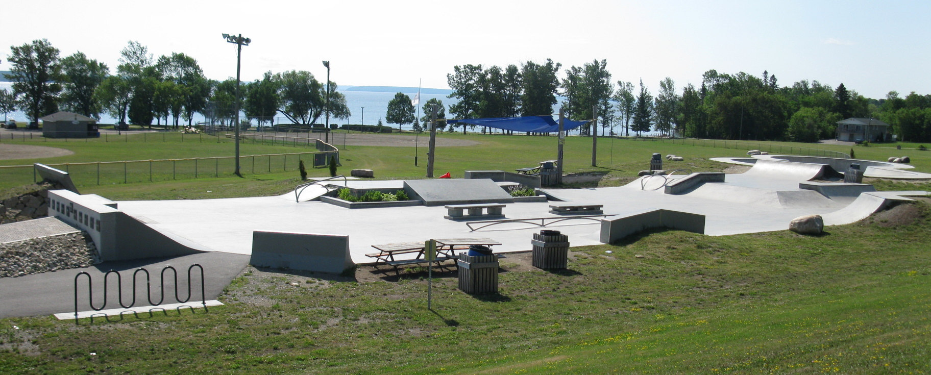 Empty skatepark overlooking the lake